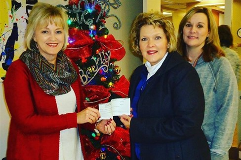 CCES PTO Donation from Lowell King Insurance