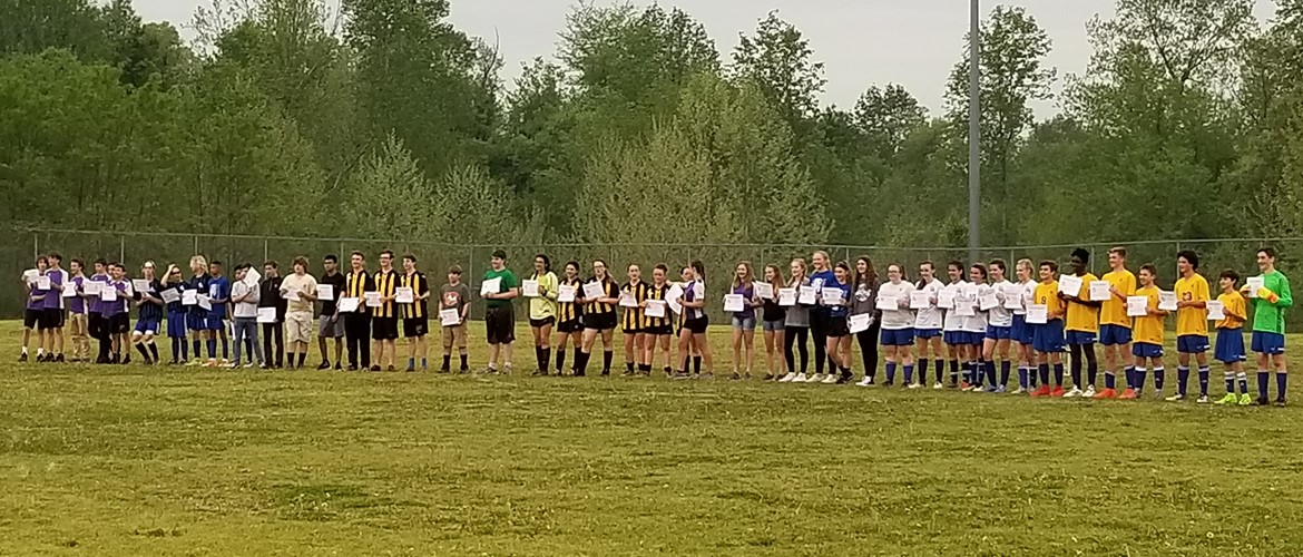Mason Underwood with the All-District Soccer Team Not Pictured: Katie Richardson and Zayvion Hall